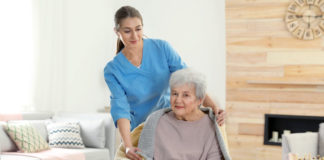 nurse covering elderly